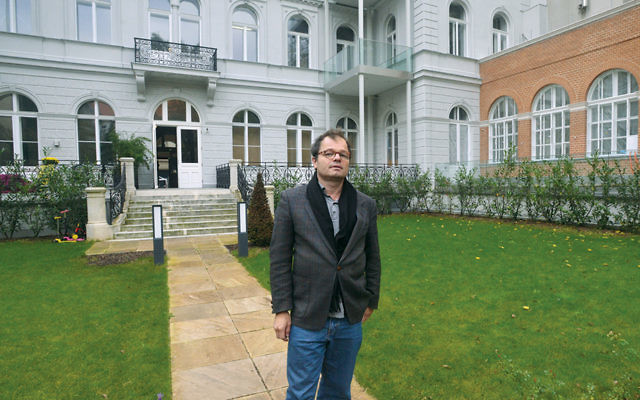 Stephan Templ stands outside a building in Vienna that he claimed from the Austrian state on October 27, 2014. (Cnaan Liphshiz)