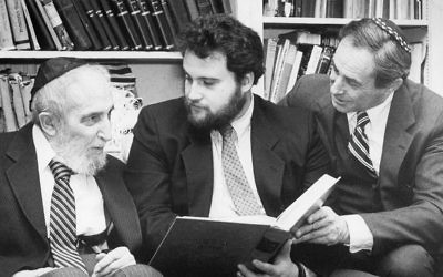Three generations of Finkelstein — Rabbi Louis, not-yet-rabbi Joshua, and Rabbi Ezra — sit together.