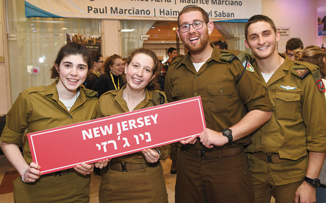 From left, Shevy Schwartz, Sophie Dubitsky, Shlomo Kroopnick, and Yossi Giller all are Bergen County lone soldiers at Yom Siddurim. (Shahar Azran)