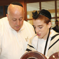 """Jacob Weinstein, A""""H, with a student"""