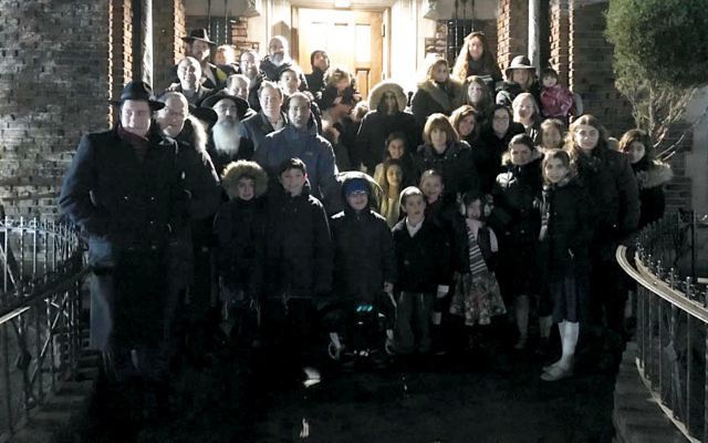 The group in front of 770 Eastern Parkway in Brooklyn on Saturday night. (Courtesy LOTP)