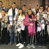 Members of Temple Emanuel of the Pascack Valley participated in the World Wide Wrap at their Sunday morning minyan on February 4. (Photo provided)
