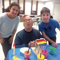 Residents of the Jewish Association for Developmental Disabilities (J-ADD) group home visited with seventh graders in the Howard and Joshua Herman Education Center at the Fair Lawn Jewish Center/Congregation B'nai Israel. Together they created Tu b'Shvat projects. (Rabbi Ronald Roth)