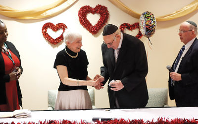Michael Shapiro, 73, presents a ring to Charlotte Poole, 69, during their commitment ceremony at the Jewish Home at Rockleigh.