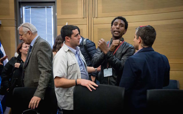 South Tel Aviv residents reacting at an Interior Affairs Committee meeting regarding the deportation of African asylum seekers at the Knesset, the Israeli parliament in Jerusalem, Jan. 29, 2018. (Miriam Alster/Flash90)