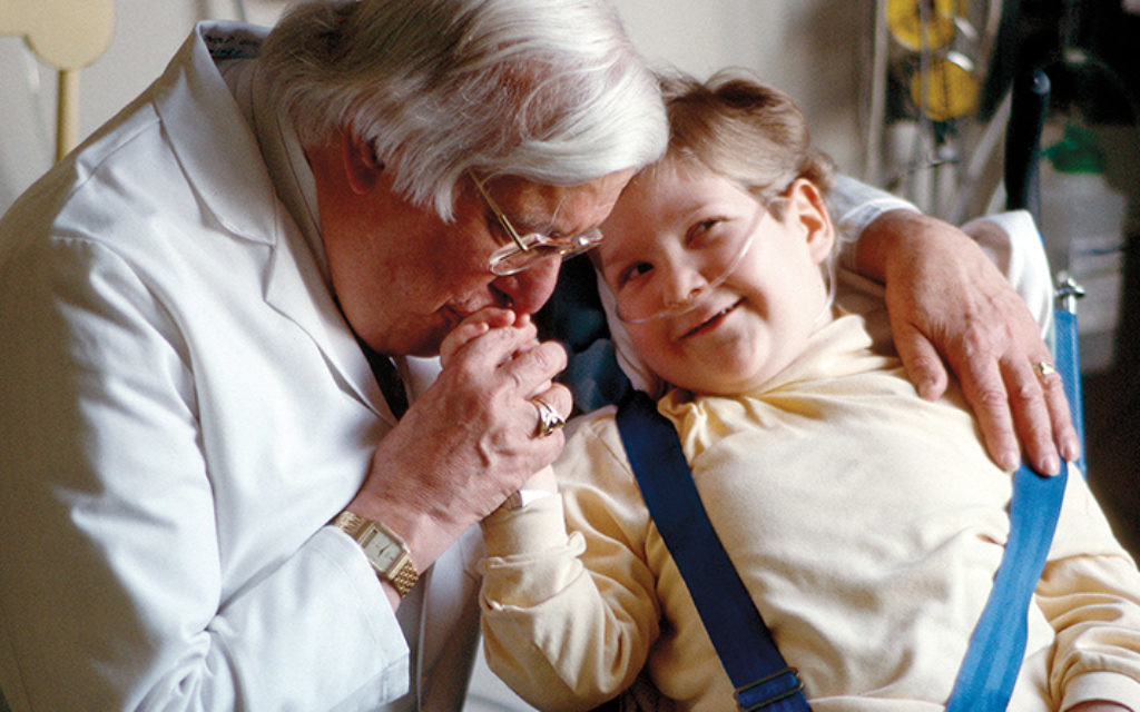Dr. Arnold P. Gold with a patient, Christopher Savage, in the 1990s at the Babies Hospital at the NewYork Presbyterian-Columbia University campus (now Morgan Stanley Children's Hospital). (René Perez)