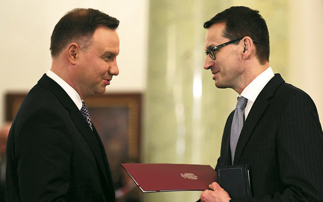"""Polish President Andrzej Duda, left, nominates Mateusz Morawiecki as prime minister at the presidential palace in Warsaw on December 11, 2017. Both support the controversial law on the term """"Polish death camps."""" (Janek Skarzynski/AFP/Getty Images)"""