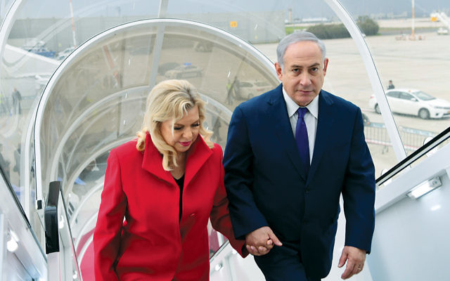 Prime Minister Benjamin Netanyahu and his wife, Sara, leave Israel for Davos last month. (Amos Ben-Gershom/GPO)