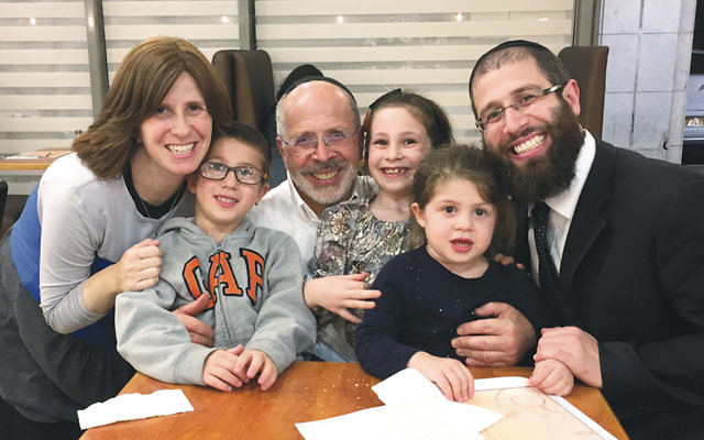 Rabbi Shmuel Goldin beams with some of his Israeli grandchildren (and their parents, too!).
