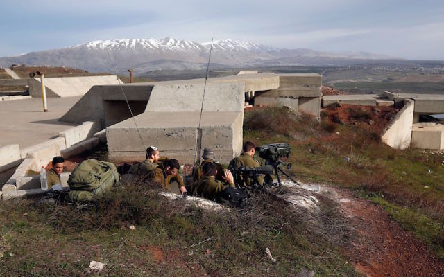 Israeli soldiers taking positions near the border with Syria, Feb. 10, 2018. (Jalaa Marey/AFP/Getty Images)
