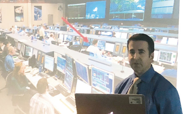 Arrow shows Aaron Brown's seat in mission control.