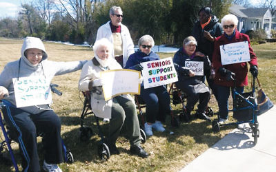 Seniors rallied outside Brightview Senior Residence in Paramus.