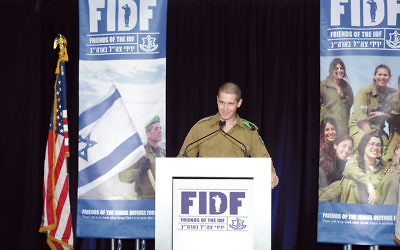 Harrison Adler, who grew up in Tenafly and was a lone soldier, speaks for the FIDF in 2015. (FIDF)