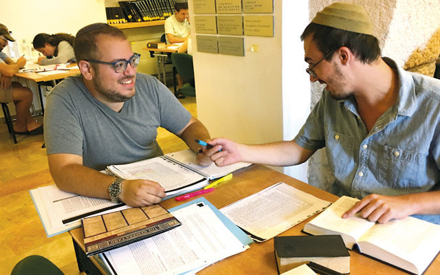 Eric Leiderman, left, and Matthew Nelson of Rockland County, who went to Reuben Gittelman in New City, learn together in the beit midrash of the Conservative Yeshiva in Jerusalem.