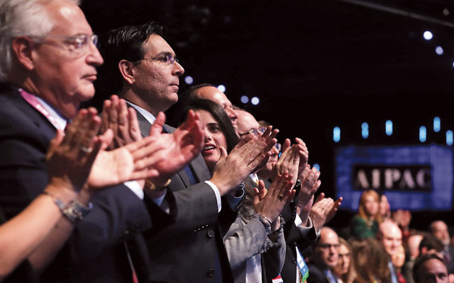 From left, U.S. Ambassador to Israel David Friedman, Israeli Ambassador to the U.N. Danny Danon, and Israeli Minister of Justice Ayelet Shaked applaud for Vice President Mike Pence as he addresses the AIPAC policy conference on Monday. (Chip Somodevilla/Getty Images)