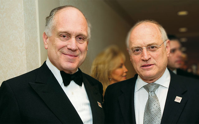 Malcolm Hoenlein, right, is with Ronald Lauder at the Apollo Theater in Manhattan on March 16, 2011. (Shahar Azran/WireImage/Getty Images)