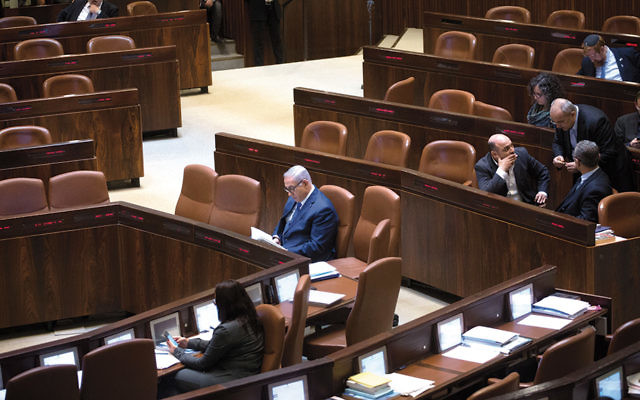 Israeli Prime Minister Benjamin Netanyahu prepares during a plenum session earlier this week. (Miriam Alster/Flash90)