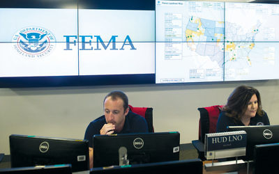 Employees are at work inside the FEMA Command Center in Washington, D.C. (Saul Loeb/AFP/Getty Images)