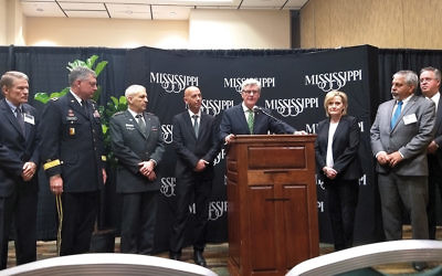 Mississippi's Gov. Phil Bryant stands at a press conference with Israeli officials at the Homeland Defense and Security Summit in Biloxi on March 13, 2018. (Ben Sales)