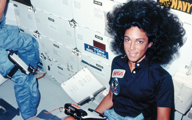 Mission specialist Judith Resnik sends a message to her father from the shuttle Discovery on its maiden voyage, August 30, 1984. (NASA/Space Frontiers/Getty Images)