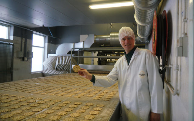 Pieter Heijs shows his product at his Hollandia Matzes factory in Enschede, the Netherlands, March 19, 2018. (Cnaan Liphshiz)