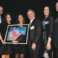 From left, Lawrence Inserra III, Lindsey Inserra-Hughes, Marie Inserra, Lawrence R. Inserra Jr., and Inez Inserra accept the award that longtime Sinai community partner Michael Maron, president and CEO of Holy Name Medical Center, standing at the right, presented to them.