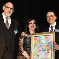Rabbi Mark Karasick,  chairman of Sinai Schools, stands with honorees Amy and  Dr. Joshua Fogelman.