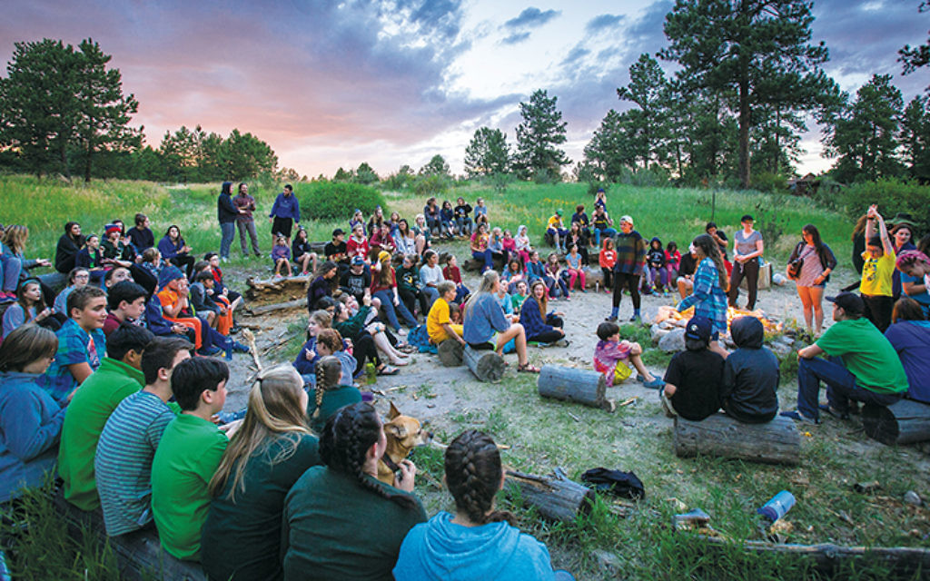 Campers sing around the campfire at JCC Ranch Camp in CaliforniaFoundation for Jewish Camp