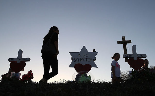 A makeshift memorial erected in front of Marjory Stoneman Douglas High School in Parkland, Fla., days after the shooting that left 17 students and teachers dead, Feb. 18, 2018. Alex Schachter, 14, was among the victims. (Joe Raedle/Getty Images)