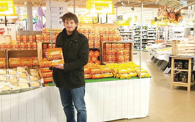 A shopper browses for matzah at the Amsterdam Noord branch of the Jumbo supermarket chain. (Cnaan Liphshi)