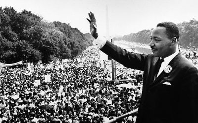 """Martin Luther King Jr., stands on the steps of the Lincoln Memorial as he delivers his famous """"I Have a Dream,"""" speech during the Aug. 28, 1963, march on Washington, D.C. (Wikimedia Commons)"""
