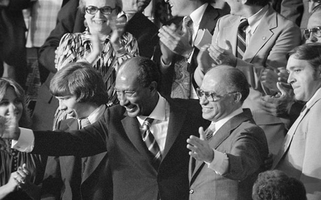 Egyptian President Anwar Sadat and Israeli Prime Minister Menachem Begin acknowledge applause during a joint session of Congress, as President Jimmy Carter announced the results of the Camp David Accords, on September 18, 1978. (Wikimedia Commons)