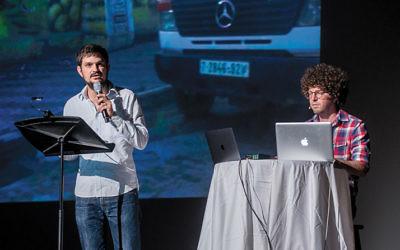 Yochai Maital and Mishy Harman tell an Israel Story onstage.