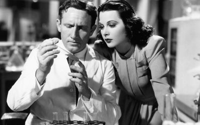 """Although she was an inventor in real life, Hedy Lamarr lets Spencer Tracy play chemist in """"I Take This Woman,"""" in 1940. (Everett Collection)"""