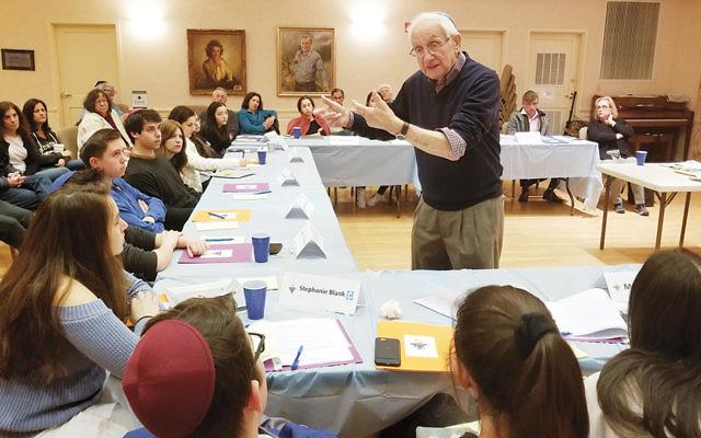 Holocaust survivor Sam Bradin addresses the high school students. (Courtesy Chabad)