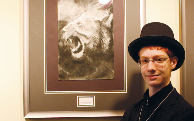 """Judah Gross, a junior at Sinai's Maor High School at Rae Kushner Yeshiva High School, stands next to his charcoal work, displayed at NJPAC. Judah was selected as an exhibiting artist in the """"Late Winter"""" exhibit sponsored by the Art Educators of New Jersey. (Courtesy Sinai)"""