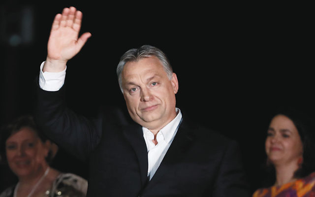 Hungarian Prime Minister Viktor Orban addresses supporters in Budapest on April 8, 2018, after winning another term in a parliamentary election. (Laszlo Balogh/Getty Images)