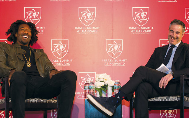Amar'e Stoudemire, left, talks with Jon Frankel at the Israel Summit at Harvard University in Cambridge, Mass., on April 8, 2018. (Collin Howell/Israel Summit at Harvard)