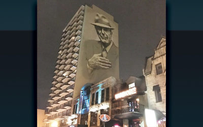 A mural of Leonard Cohen towers above Crescent Street in downtown Montreal.