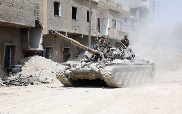 Syrian Army soldiers advancing in an area on the eastern outskirts of Douma, April 8, 2018. (Stringer/AFP/Getty Images)