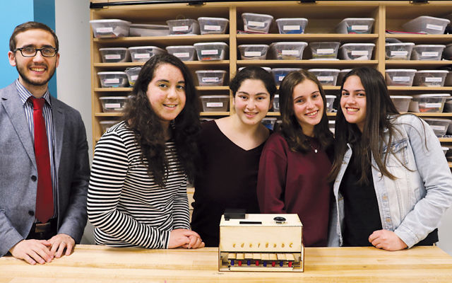 "Ma'ayanot students and a faculty member pose with their ""Piano PT"" invention: Aryeh Tiefenbrunn, Atara Weil, Tzivia Major, Daniella Shlagbaum, and Hannah Samuel."