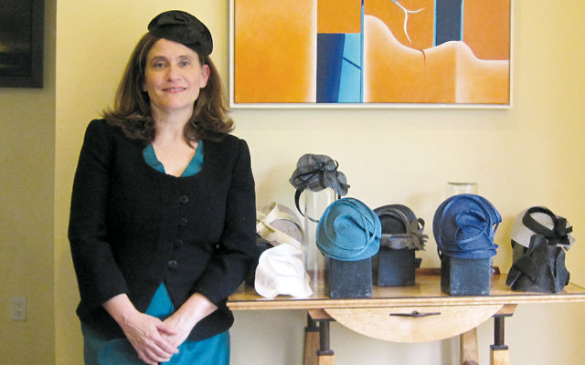 Sarah Wagner stands by some of her fascinators.