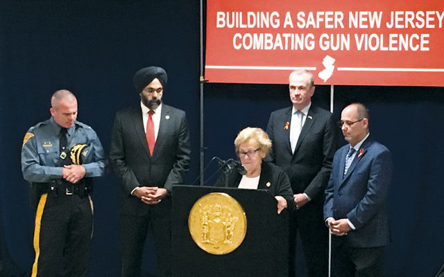 State Senate Majority Leader Loretta Weinberg of Teaneck addresses a conference against gun violence at the Hackensack Performing Arts Center. With her are, from left, State Police Superintendent Col. Patrick J. Callahan, New Jersey Attorney General Gurbir S. Grewal, Governor Phil Murphy, and Fred Guttenberg.