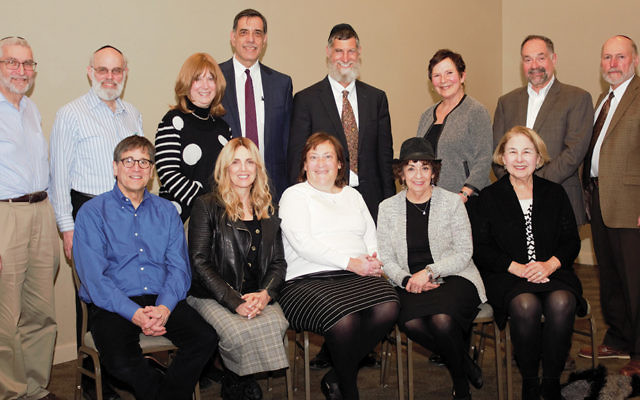 Committee members, standing, from left, David Fox, Jim Schwartz, Barbara Rotenberg, Steve Fox (co-chair), Rabbi Hanoch Teller, Roz Hantman, Tzvi Fishman, and Alan Hantman. Seated, from left, Bruce Prince, (co-chair), Rochelle Goldschmiedt, Felicia Grossman, Chani Jaskoll, and Fran Ebel. (Photo provided)