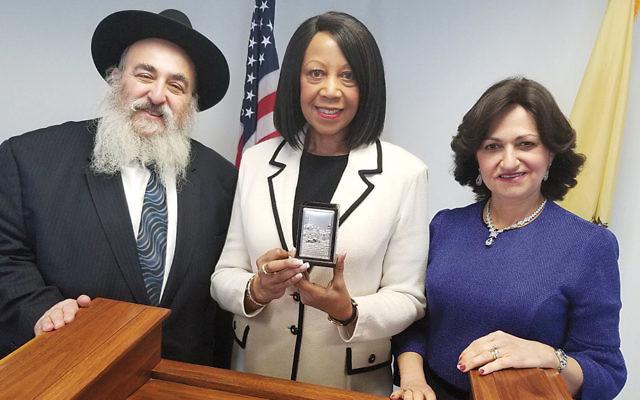Rabbi Mordechai and Shterney Kanelsky flank Lt. Governor Sheila Oliver. (Courtesy Bris Avrohom)