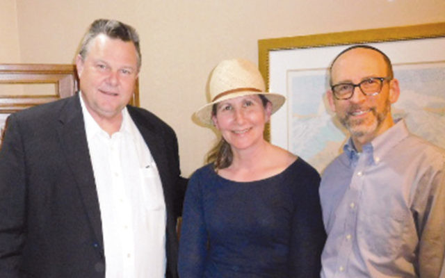 Senator Jon Tester, left, with Leah and Reuven Escott