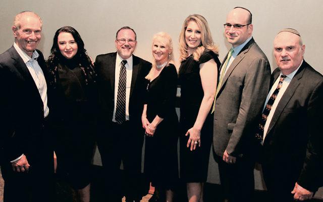 BCHSJS board president Sy Blechman, left, stands with Alla Fine, Rabbi Dr. David Fine, Deborah Lesnoy, Heidi and Seth Seigel-Laddy, and Fred Nagler, BCHSJS's principal and director. (Jo Rosen Photography)