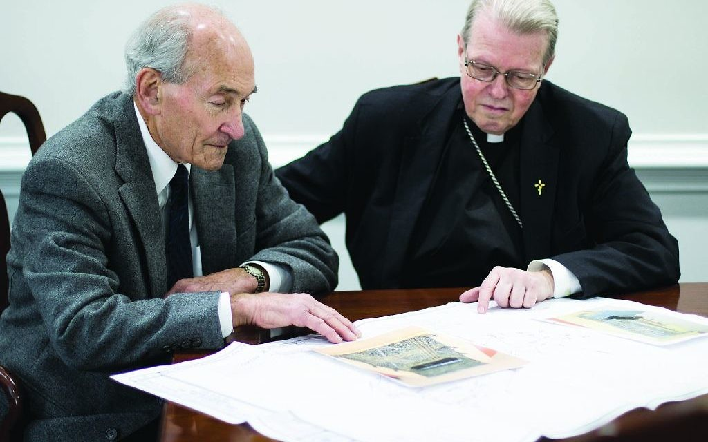 Dr. Michael Lozman and Bishop Edward Scharfenberger go over plans for an interfaith Holocaust memorial outside Albany, New York.