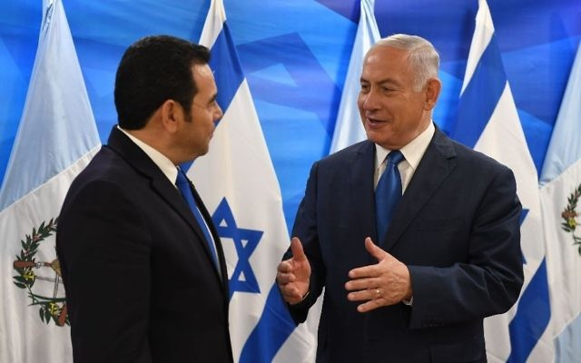 Guatemalan President Jimmy Morales, left, meets at the Prime Minister's Office in Jerusalem with Benjamin Netanyahu on May 16, 2018, after the dedication of his country's embassy in the city. (Mark Neiman/GPO)
