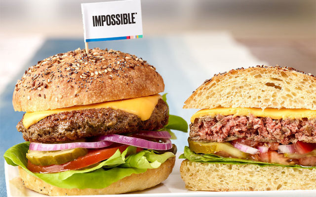 "The Impossible Burger has made waves for ""bleeding"" like a normal beef patty. (Courtesy of Leo Gong/Impossible Foods)"